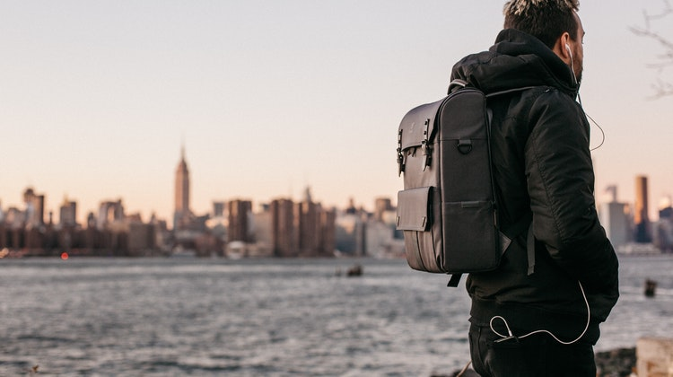 guy-carrying-rucksack-city