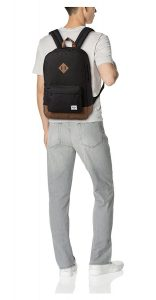 guy wearing herschel backpack